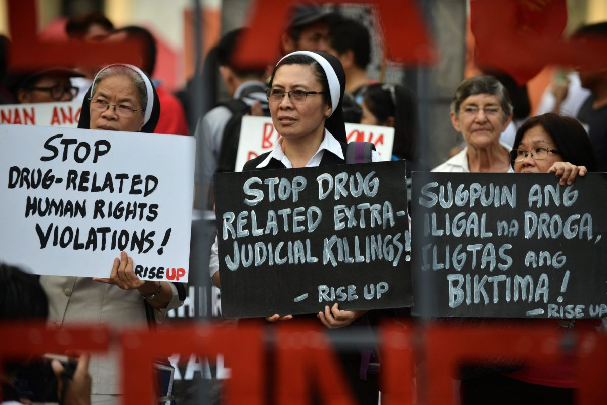 Catholic nuns hold placards as they protest against what organisers say are drug-related extrajudicial killings, during the International Human Rights Day in Manila, Philippines December 10, 2016. Photo: Reuters/Ezra Acayan