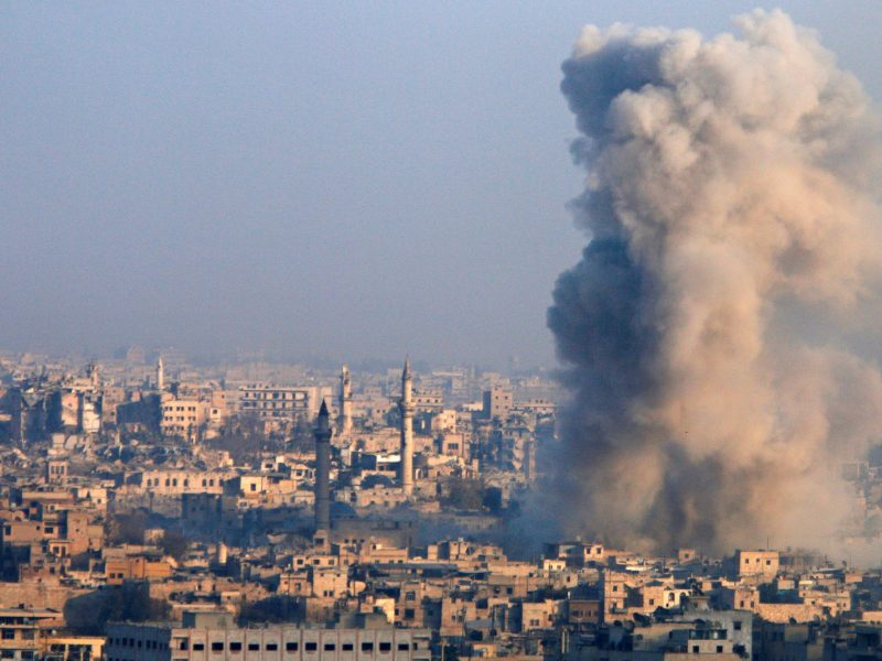 Smoke rises as seen from a rebel-held area of Aleppo, Syria December 12, 2016. Photo: Reuters/Abdalrhman Ismail