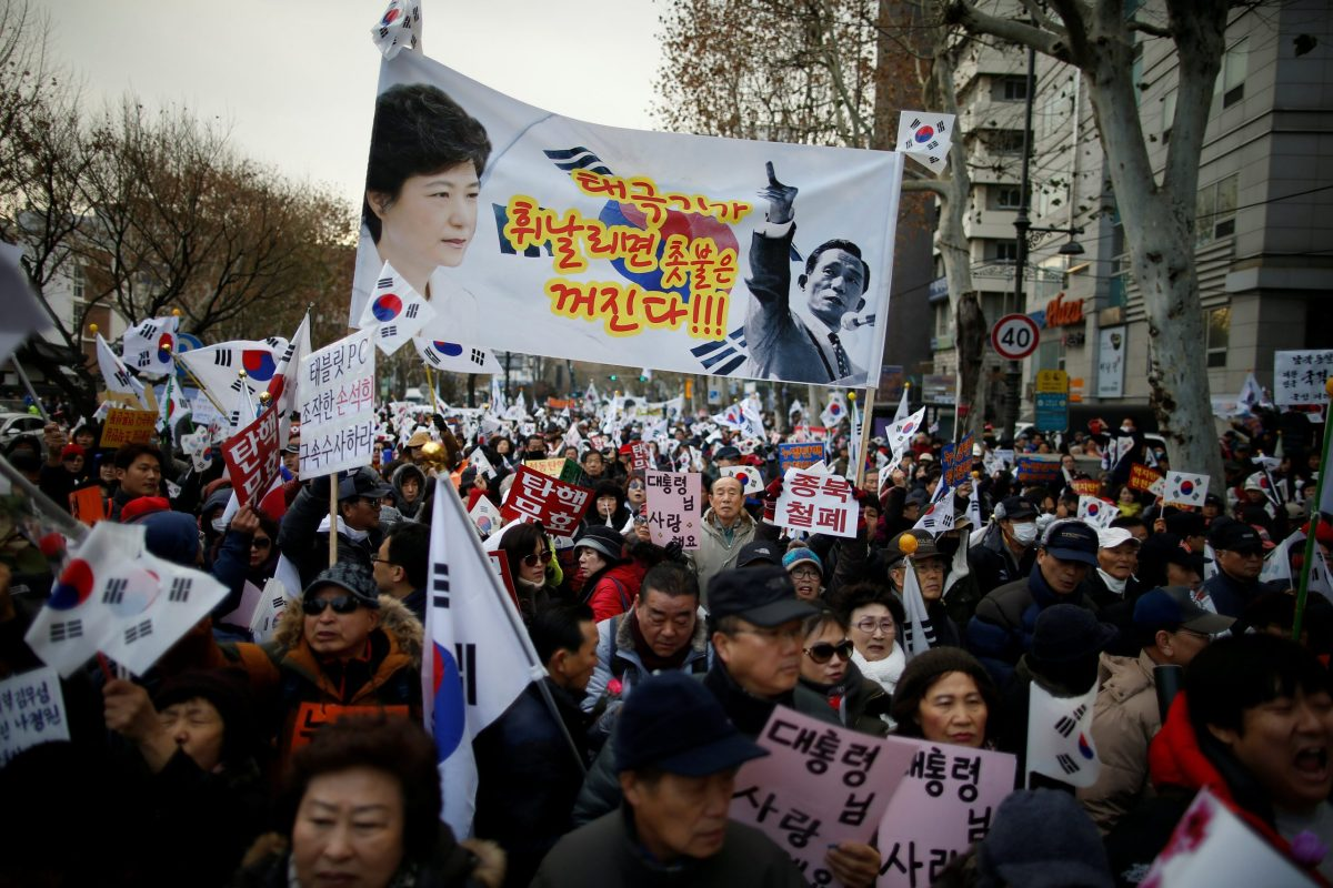 A banner bearing images of South Korean President Park Geun-hye and her father, the late South Korean former military dictator Park Chung-hee at a protest opposing her impeachment near the constitutional court in Seoul, South Korea, December 17, 2016. Photo: Reuters/Kim Hong-Ji