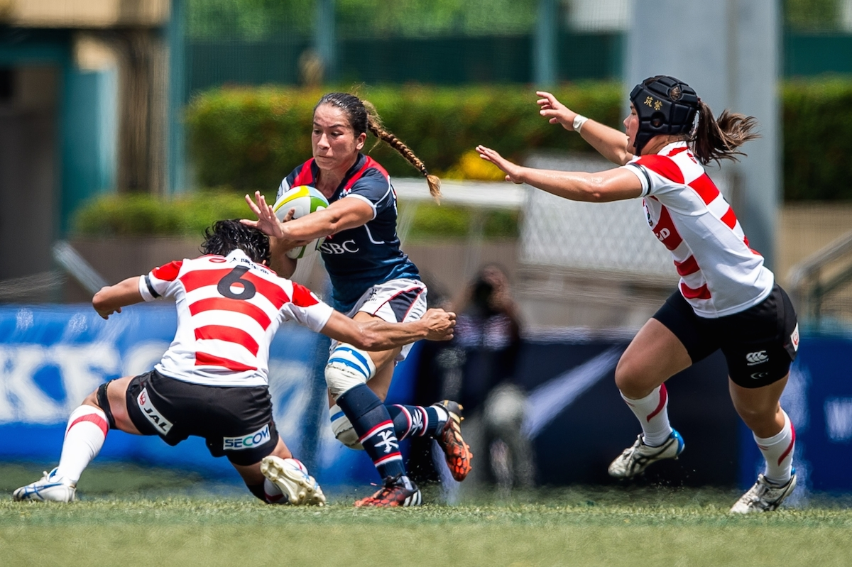 Hong Kong's Rose Fong fends off Japanese tackles  during the Asia Women's Rugby Championships earlier this year. Photo: Ike Li / ikeimages