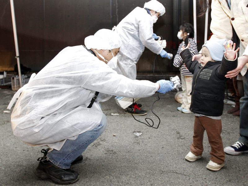 Officials check for radiation on children evacuated from the area near the Fukushima nuclear disaster in March 2011. REUTERS/Kim Kyung-Hoon
