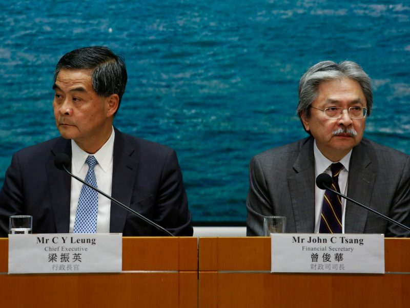 Hong Kong Chief Executive Leung Chun-ying (L) and Financial Secretary John Tsang see their political futures going in different directions.     REUTERS/Bobby Yip