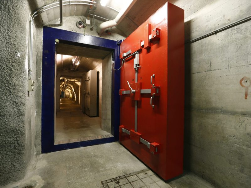 Two heavy doors protect a tunnel inside a former Swiss mlitary command bunker near Attinghausen, Switzerland September 2, 2015. Deltalis data centre offers high security storage of data in server rooms inside of the former command bunker, which was built in 1948. Picture taken on September 2, 2015.  REUTERS/Arnd Wiegmann