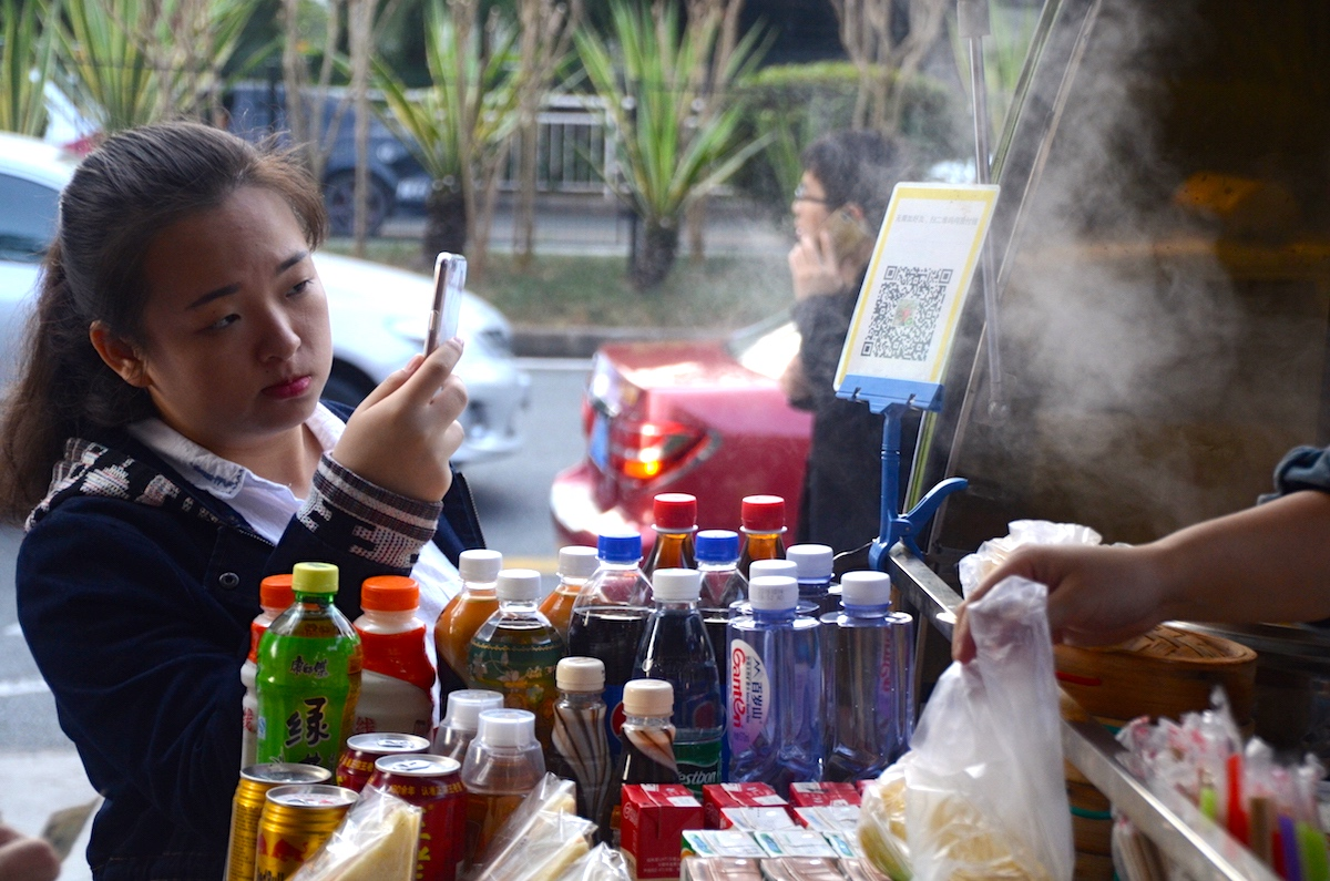A customer uses the mobile payment at a noodle stand in Shenzhen. Photo: Johan Nylander