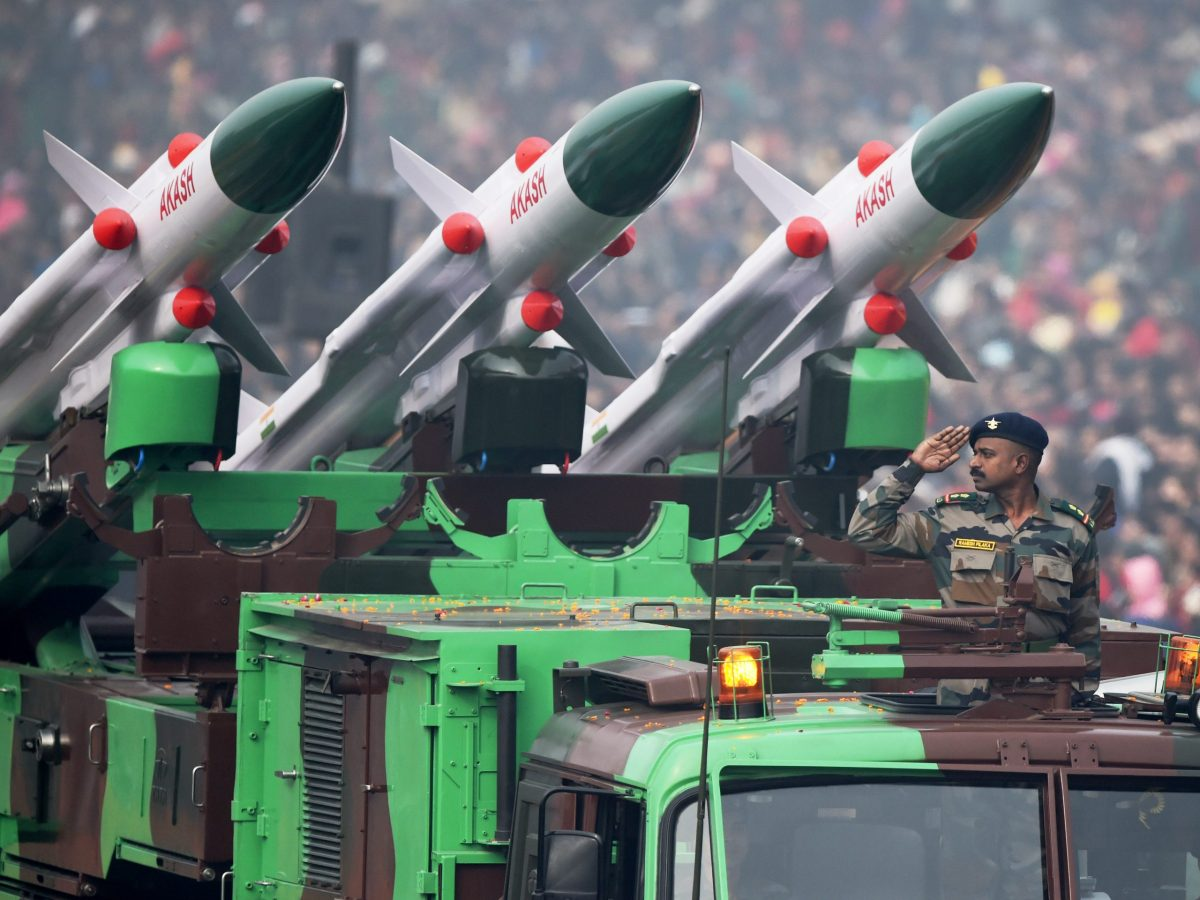 An Indian soldier salutes as he rides an Akash air defence system during India's Republic Day parade in New Delhi on January 26, 2016. Photo: AFP / Roberto SCHMIDT
