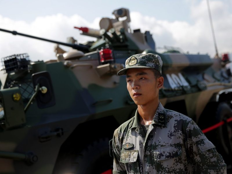 A Chinese Peoples' Liberation Army (PLA) soldier stands to attention. Beijing is lifting pay for troops and aiming to boost welfare for disbanded servicemen with the creation of a Veterans Affairs Ministry. Photo: AFP/Isaac Lawrence