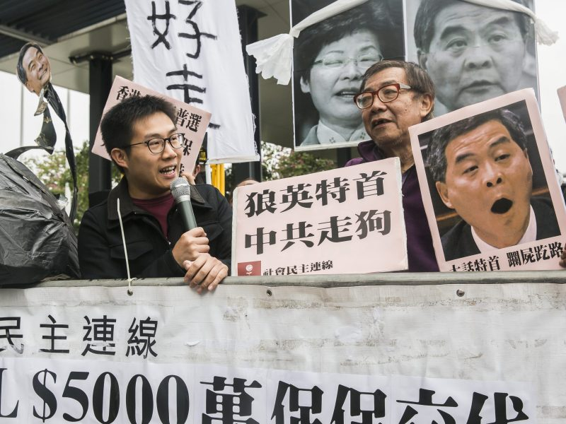 League of Social Democrats party member Raphael Wong protests ahead of Chief Executive Leung Chun-ying's final policy address to the Legislative Council on January 18, 2017. Photo: AFP/Isaac Lawrence