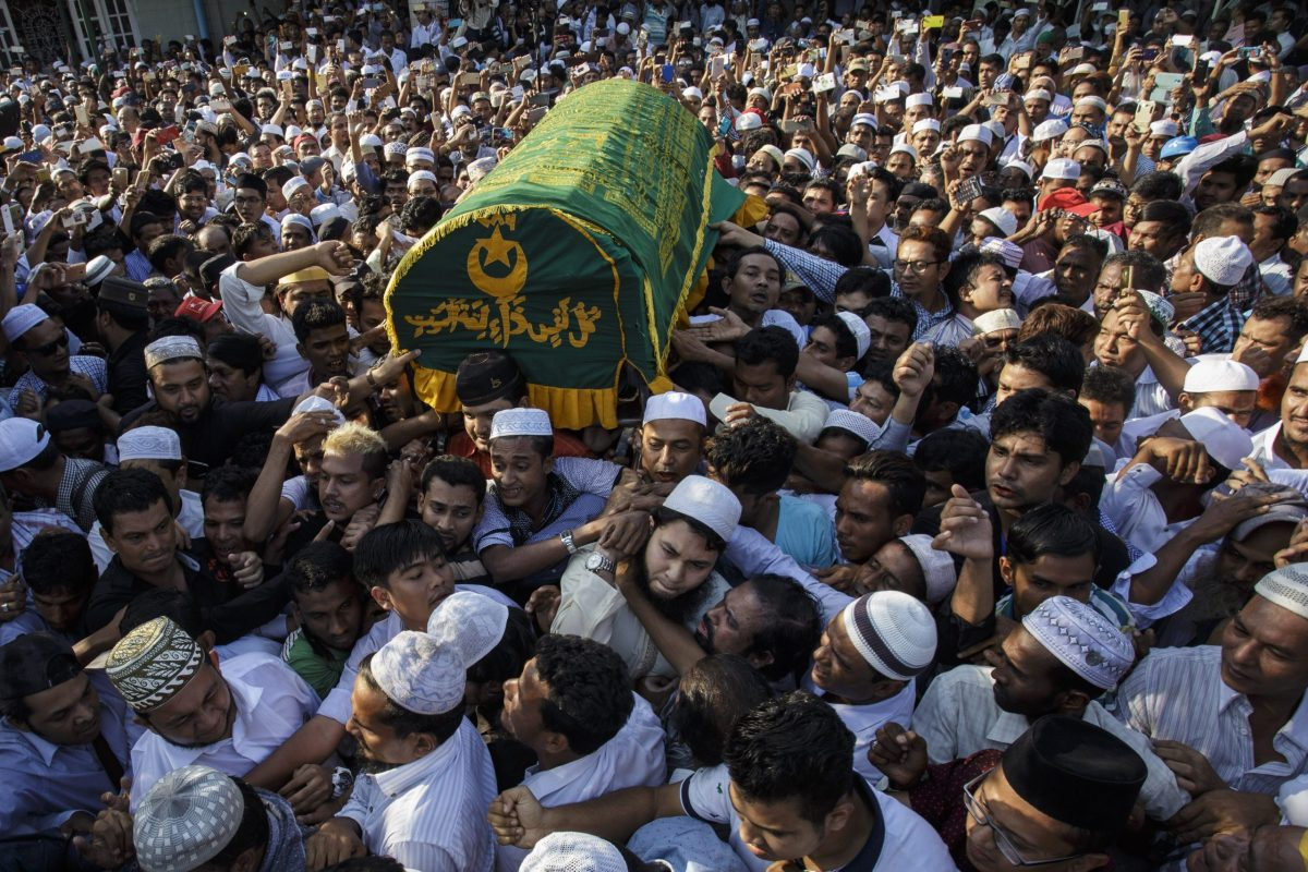 People carry the coffin of prominent Muslim lawyer Ko Ni during a funeral ceremony held in Yangon, Myanmar on January 30, 2017. Ko Ni was shot in the head at Yangon International Airport on Sunday evening as he returned from a visit to Indonesia as part of a Myanmar delegation of Muslim leaders and government officials. Photo: Kyaw Kyaw / Anadolu Agency