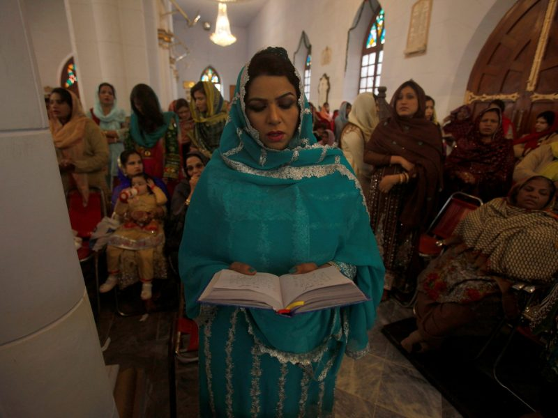 A woman attends a mass on Christmas Day at the St. John Cathedral Church in Peshawar, Pakistan, December 25, 2016. REUTERS/Fayaz Aziz