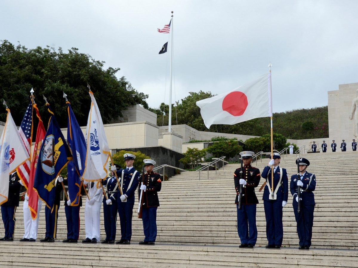 """The U.S. military Color Guard post the """"Colors"""" along with the Japanese flag at the National Memorial Cemetery of the Pacific at Punchbowl in Honolulu, Hawaii, U.S. December 26, 2016. Reuters/Hugh Gentry"""