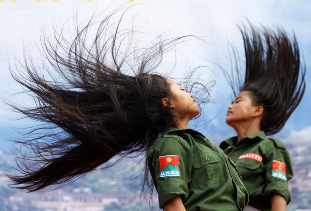 Hair-raising moment: Ethnic Wa performers dressed as United Wa State Army soldiers do a traditional dance in Mongmao. Photo:  Reuters/Soe Zeya Tun