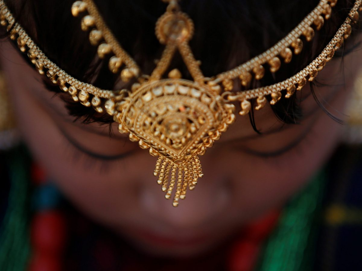 An adorned Gurung girl wearing traditional costume and ornaments is seen during Tamu Lhosar or Losar (New Year) parade in Kathmandu, Nepal December 30, 2016. Members of the community in Nepal celebrate Tamu Lhosar or Losar with a feast and various cultural programs to usher in the Gurung community's year of the bird. REUTERS/Navesh Chitrakar