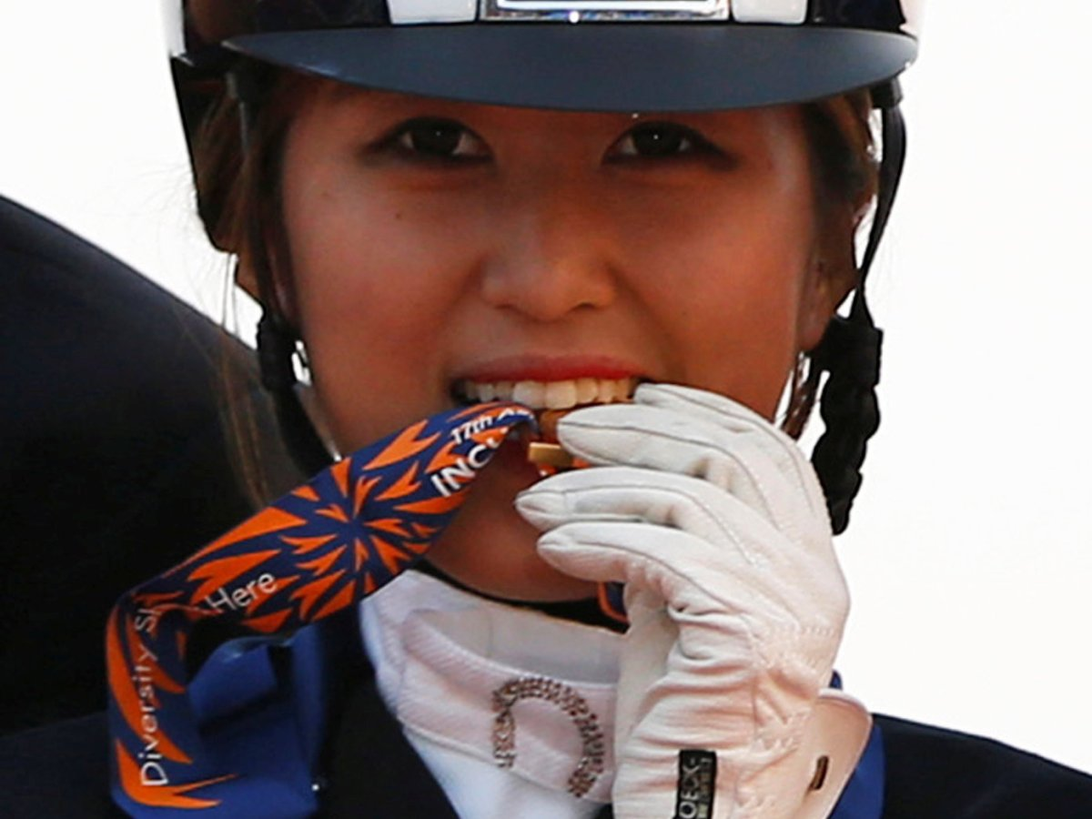 Chung Yoo-ra won a gold medal in the equestrian Dressage Team competition during the 17th Asian Games in Incheon in 2014. Photo: REUTERS/Kim Hong-Ji