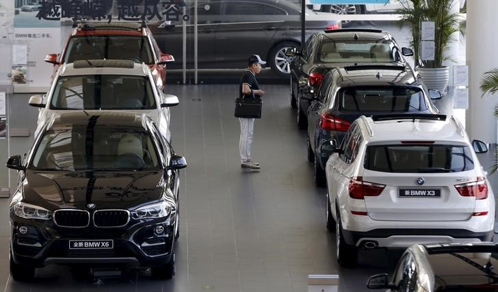A man takes a look at BMW cars at a dealer shop in Beijing. Photo: Reuters/Kim Kyung-Hoon
