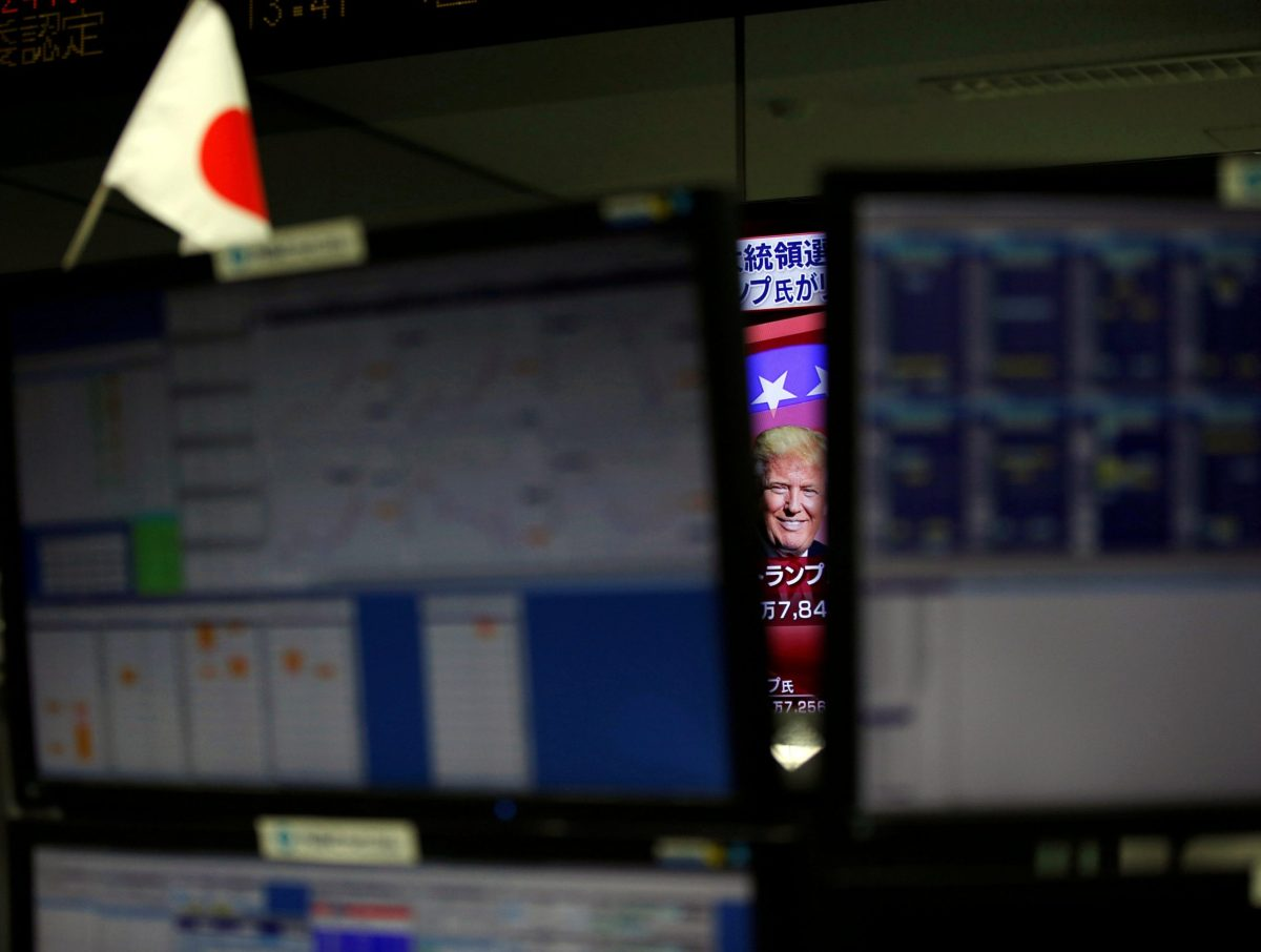 Donald Trump is seen between monitors on TV news at a foreign exchange trading company in Tokyo, Japan, November 9, 2016. Reuters/Toru Hanai