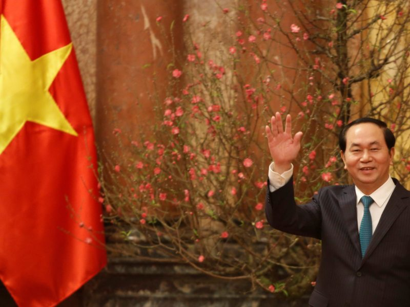 Vietnam's President Tran Dai Quang waves his hand to the media as he waits for arrival of Japan's Prime Minister Shinzo Abe at the Presidential Palace in Hanoi, Vietnam January 16, 2017. REUTERS/Kham