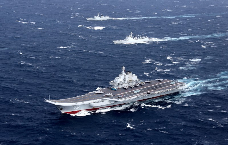 A file photo shows the Liaoning with vessels accompanying her in a drill.  Photo: Reuters