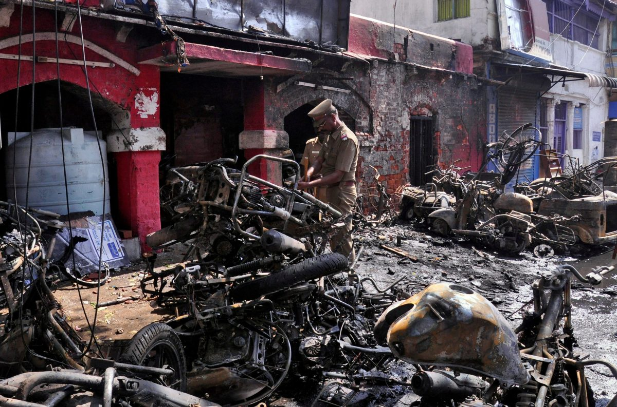 Officers inspect the charred remains of the Ice House police station in Chennai. Photo: Reuters