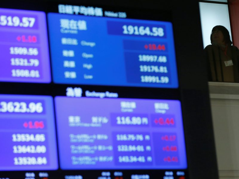 A stock quotation board displaying Japan's Nikkei average is seen before a ceremony marking the end of trading in 2016 at the Tokyo Stock Exchange (TSE) in Tokyo, Japan December 30, 2016. REUTERS/Toru Hanai