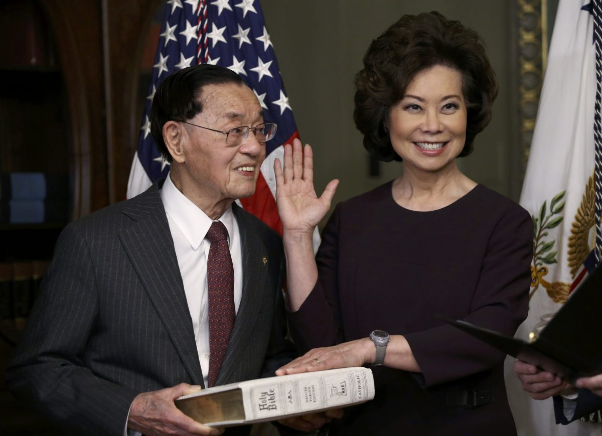 New Transportation Secretary Elaine Chao is sworn  as her father, James S.C. Chao, holds a bible during a ceremony at the White House in Washington, January 31, 2017. Photo: Reuters/Carlos Barria