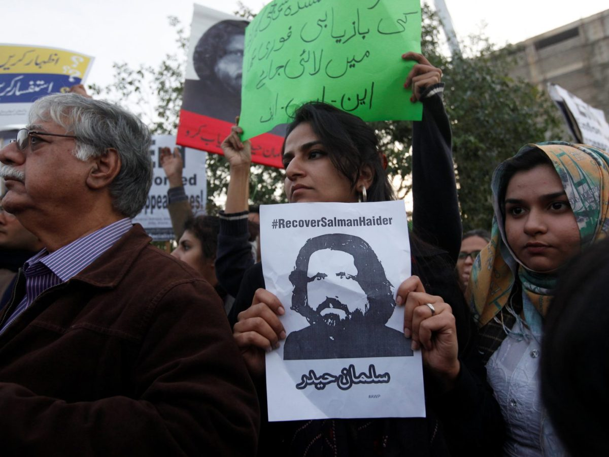 Human rights activists hold up a picture of Salman Haider, who went missing during a protest to condemn the disappearances of social activists in Karachi. Photo: Reuters