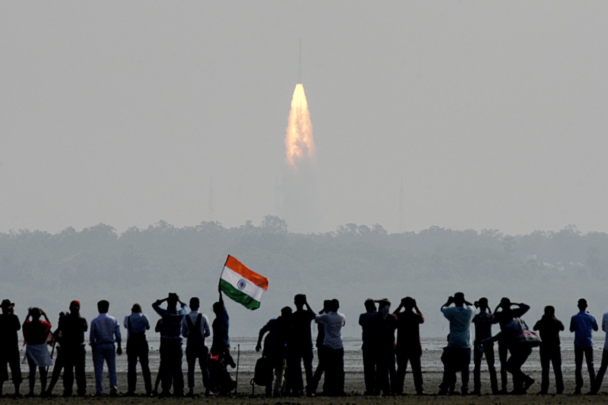 Indian onlookers watch the launch of the Indian Space Research Organisation Polar Satellite Launch Vehicle (PSLV-C37) at Sriharikota on Febuary 15, 2017. Photo: AFP/ Arun Sankar