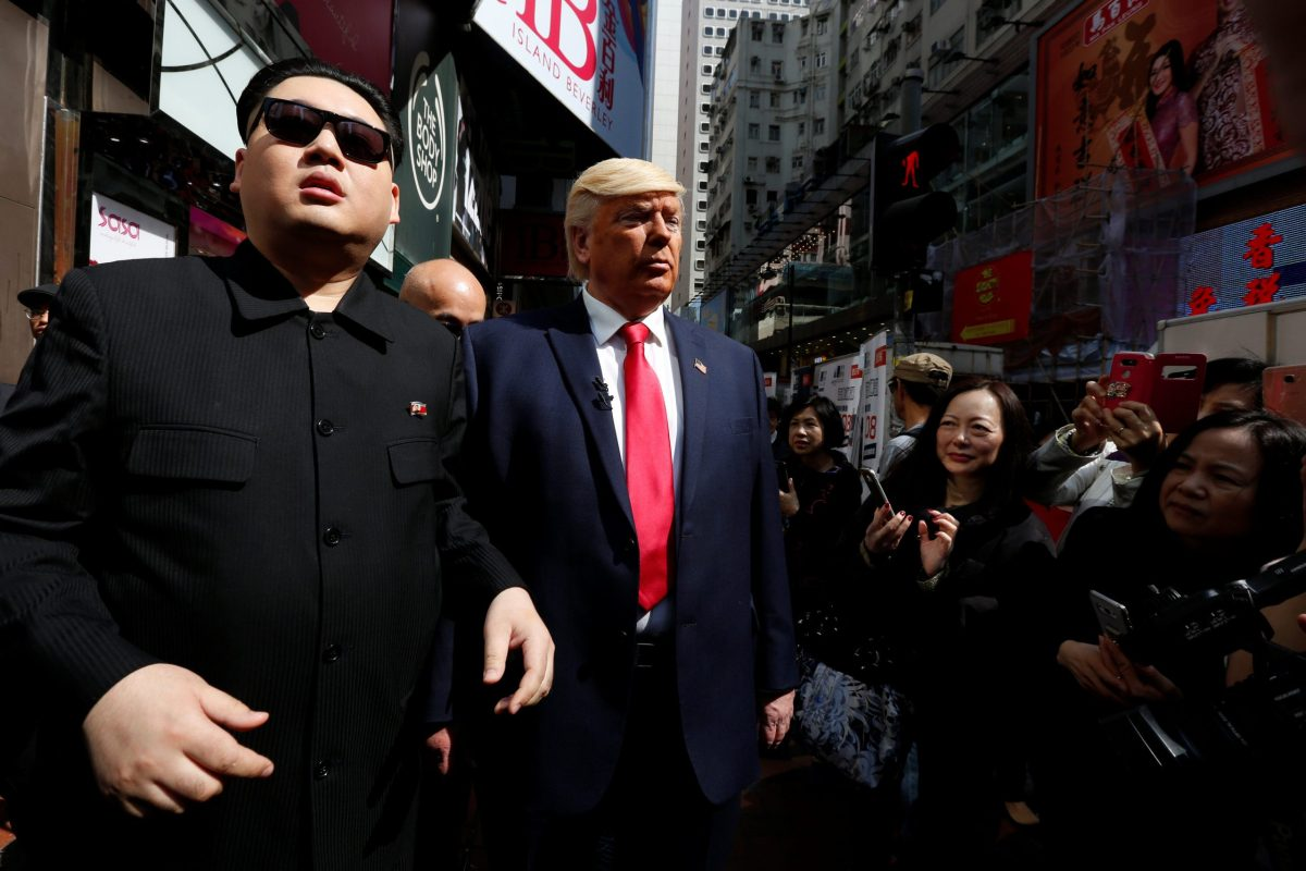 Howard, 37, an Australian-Chinese impersonating North Korean leader Kim Jong-un, and Dennis Alan of Chicago, 66, impersonating US President Donald Trump, pose on a street in Hong Kong. Photo: Reuters / Bobby Yip