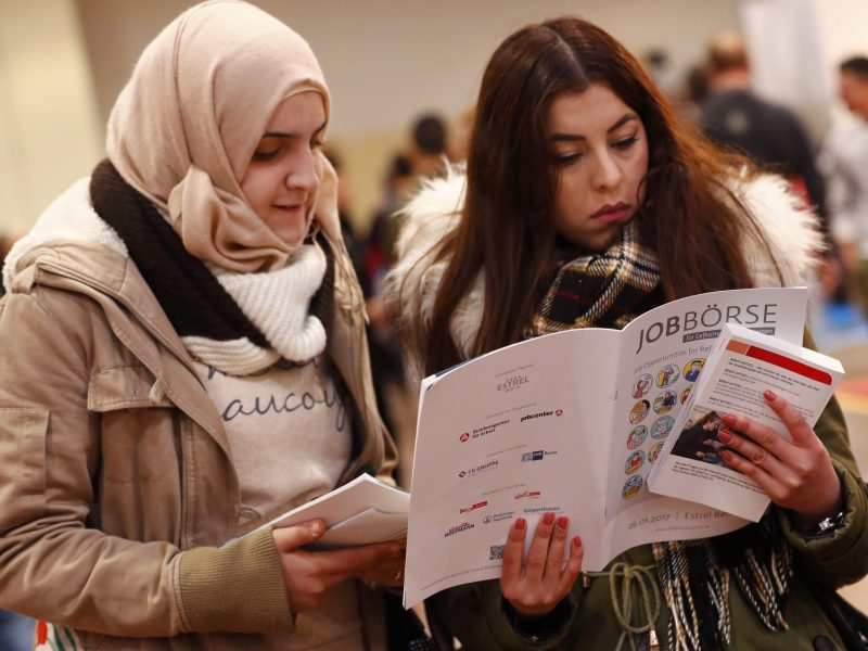 Two women visit a job fair in Berlin for migrants and refugees on January 25, 2017. Photo: Reuters / Fabrizio Bensch