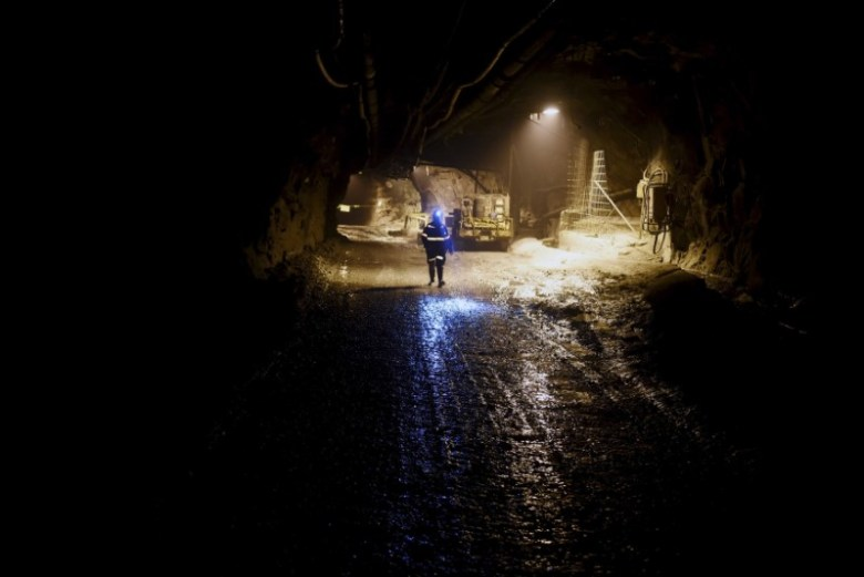 A worker walks in an underground mine, part of the Grasberg copper and gold mine operated by an Indonesian subsidiary of Freeport-McMoRan Inc, near Timika, Papua province February 14, 2015 in this photo taken by Antara Foto. REUTERS/M Agung Rajasa/Antara Foto