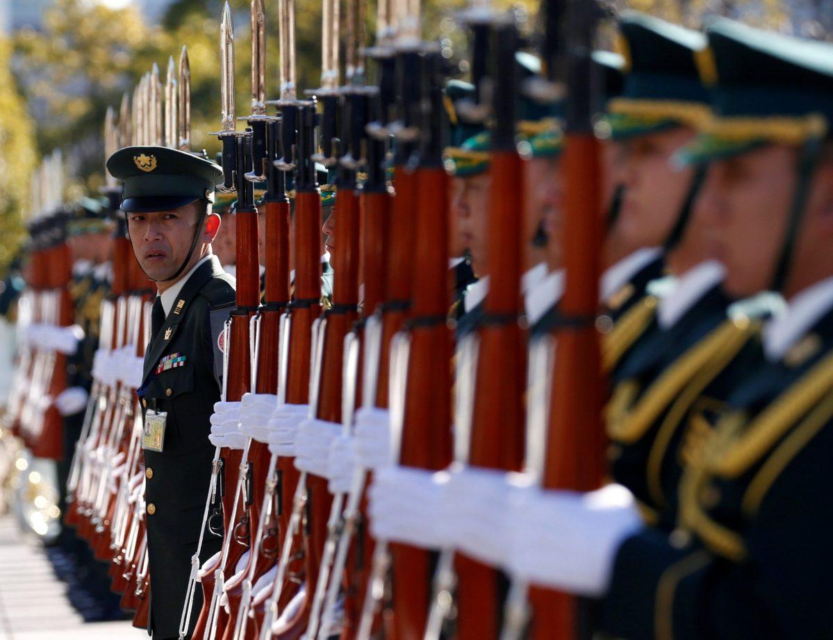 Members of Japan's Self-Defence Force's honour guard prepare for a ceremony for U.S. Defense Secretary Jim Mattis. Photo: Reuters, Toru Hanai