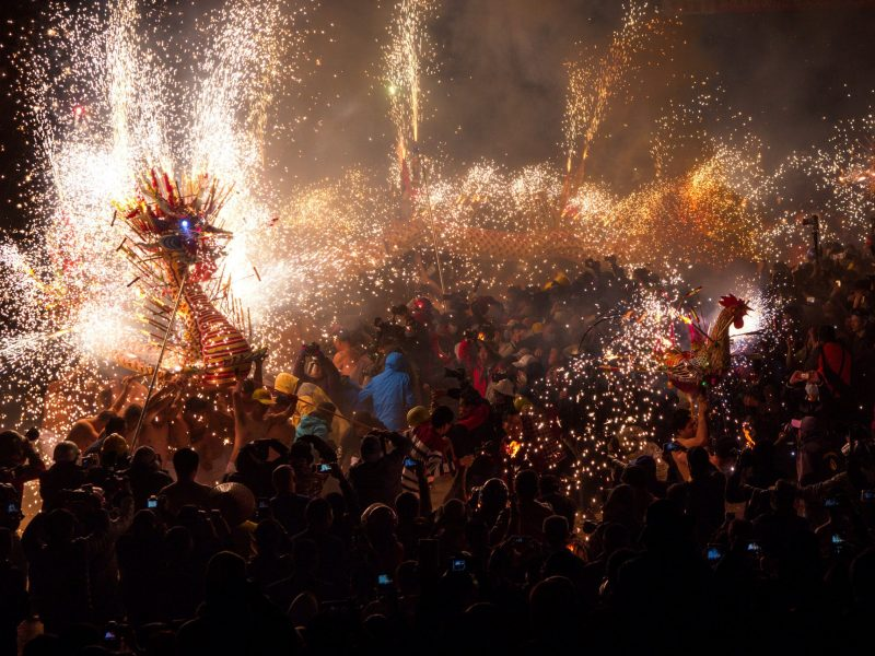 People watch a fire dragon and a fire rooster made of lanterns, firecrackers and fireworks as performers carry the lanterns to perform dances to celebrate Lantern Festival in Fengshun county, Guangdong province, China, February 11, 2017. Picture taken February 11, 2017. REUTERS/Stringer ATTENTION EDITORS - THIS IMAGE WAS PROVIDED BY A THIRD PARTY. EDITORIAL USE ONLY. CHINA OUT. NO COMMERCIAL OR EDITORIAL SALES IN CHINA.