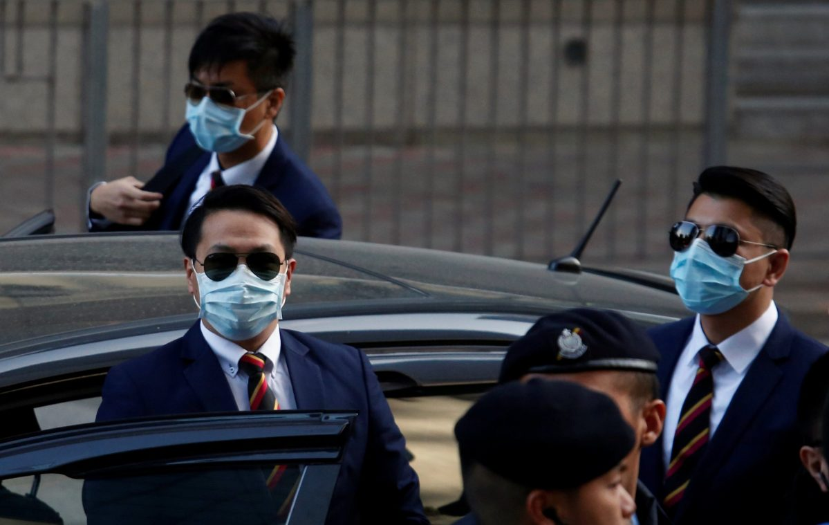 Three of the seven police officers, Police Constable Lau Hing-pui (front L), Wong Wai-ho (R) and Chan Siu-tan (back), charged in connection with the beating of a protester during Occupy Central pro-democracy demonstrations, arrive at a court in Hong Kong, China February 14, 2017.  Photo: Bobby Yip
