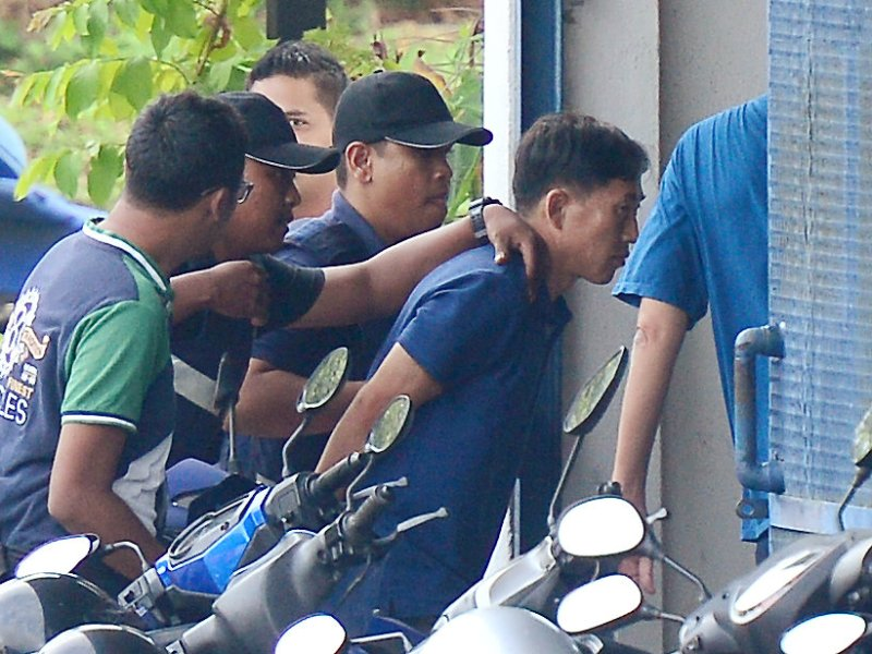 A North Korean man (right) identified by the Malaysian police as Ri Jong-chol and suspected to be in connection with the murder of Kim Jong-nam, is taken to a police station in Sepang, Malaysia. Photo: Park Jung-ho/News1 via Reuters