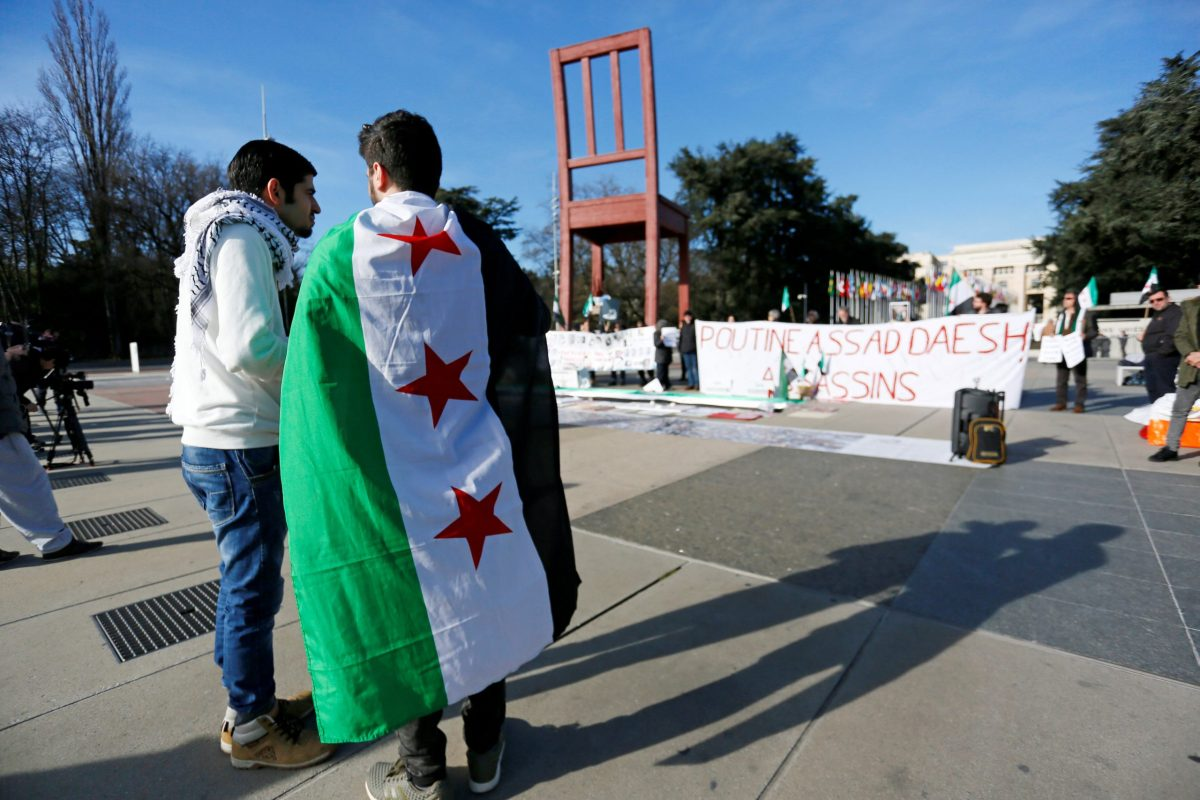 People take part in a demonstration against Syria's President Bashar al-Assad government during the United Nations Geneva IV conference. REUTERS
