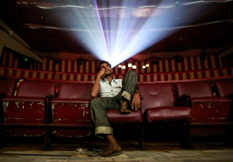 A cinema goer watches a Bollywood movie, but he may not know what the actors had to do to get a role. Photo Danish Siddiqui, Reuters