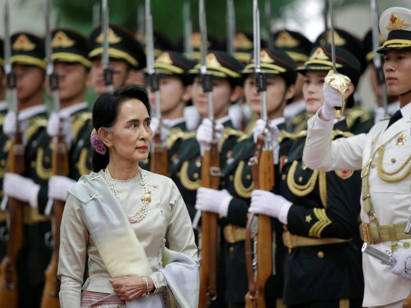 Myanmar State Counselor Aung San Suu Kyi reviews honour guards during a welcoming ceremony at the Great Hall of the People in Beijing, China, August 18, 2016. REUTERS/Jason Lee