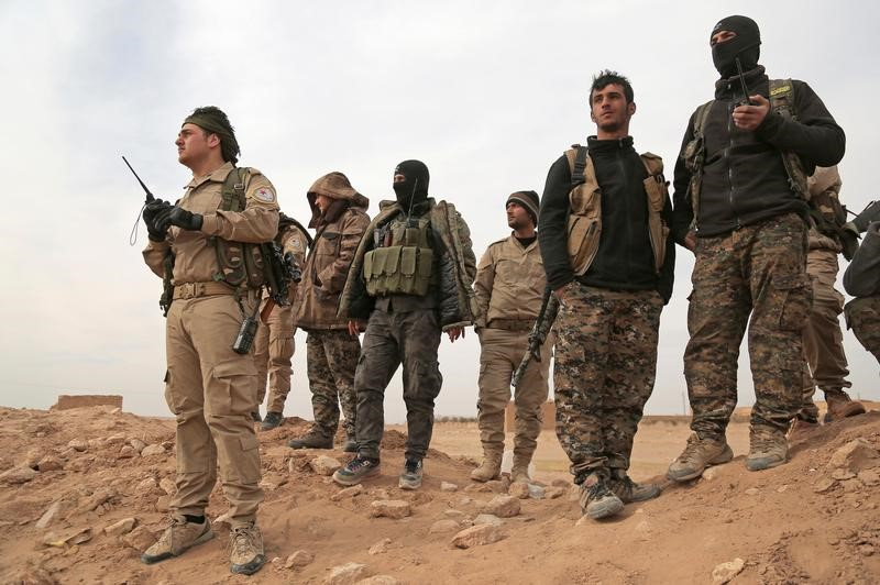 Syrian Democratic Forces (SDF) fighters gather during an offensive against Islamic State militants in northern Raqqa province in February 2017. Photo: Reuters, Rodi Said