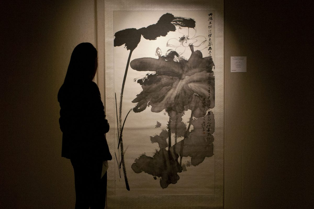 """A file photo showing Chinese artist Zhang Daqian's """"Lotus in the Wind"""" scroll painting at a 2014 Sotherby's fine Chinese paintings spring sale. In 2016, China established itself as the global superpower with Zhang Daqian's works proving especially popular. PHOTO: Agence France-Presse."""