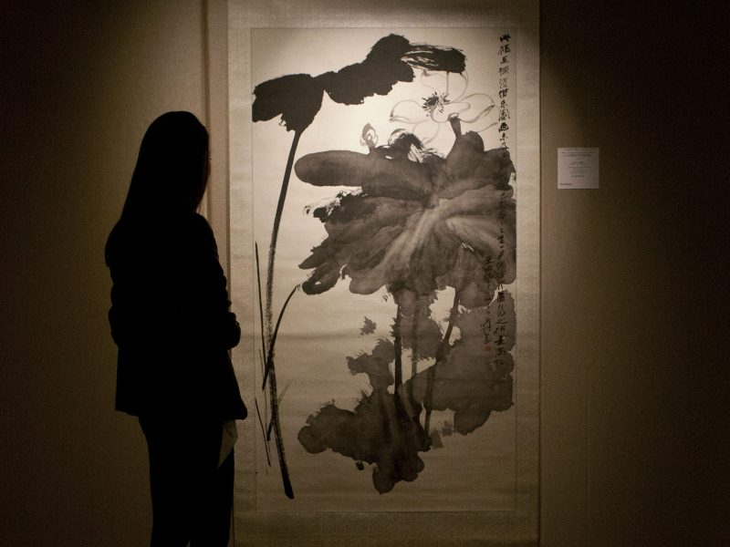 "A file photo showing Chinese artist Zhang Daqian's ""Lotus in the Wind"" scroll painting at a 2014 Sotherby's fine Chinese paintings spring sale. In 2016, China established itself as the global superpower with Zhang Daqian's works proving especially popular. PHOTO: Agence France-Presse."