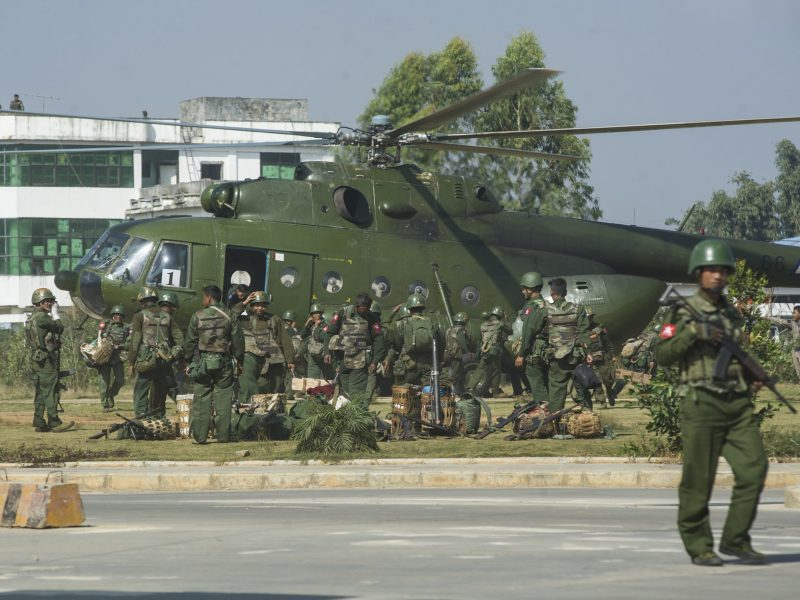 Myanmar government troops board a military helicopter in Muse located in Shan State near China's border in 2016. At least 3,000 people have fled into China due to fighting. Photo: AFP/Ko Sai
