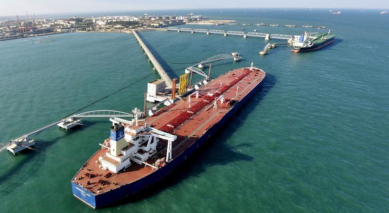 A crude oil tanker unloads at Qingdao Port, Shandong province. Photo: Reuters/Stringer