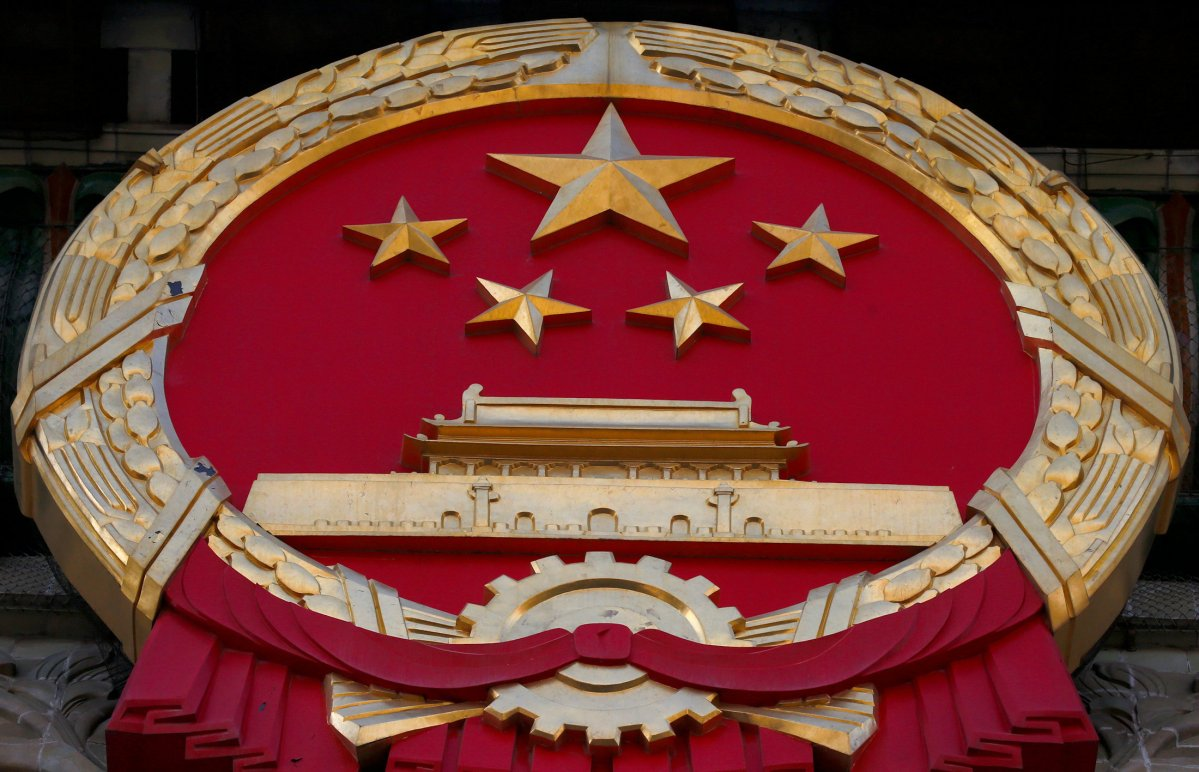 A Chinese national emblem is seen during a news conference ahead of the opening session of the Chinese People's Political Consultative Conference (CPPCC) at the Great Hall of the People in Beijing, China, March 2, 2017. REUTERS/Thomas Peter
