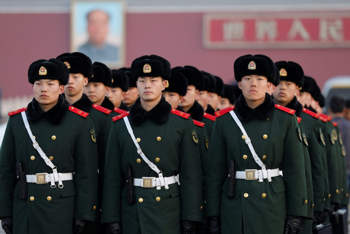Paramilitary policemen stand guard after flag-raising ceremony at Tiananmen Square ahead of the opening session of the Chinese People's Political Consultative Conference (CPPCC) in Beijing, China, March 3, 2017. REUTERS/Tyrone Siu