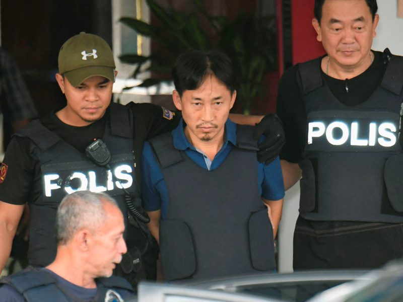 North Korean suspect in Kim Jong-nam murder, Ri Jong-chol, leaves a Sepang police station to be deported. Photo: Kyodo via Reuters.
