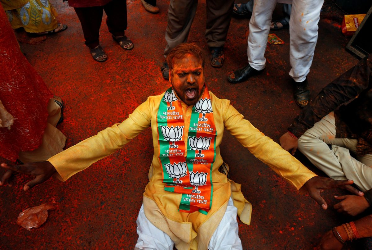 A supporter of the Bharatiya Janata Party (BJP) celebrates after learning of the initial poll results outside the party headquarters in Kolkata, India, March 11, 2017. Reuters/Rupak De Chowdhuri