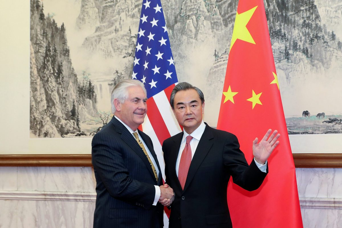 Chinese Foreign Minister Wang Yi (R) shakes hands with U.S. Secretary of State Rex Tillerson at Diaoyutai State Guesthouse on March 18, 2017 in Beijing, China. Reuters/ Lintao Zhang