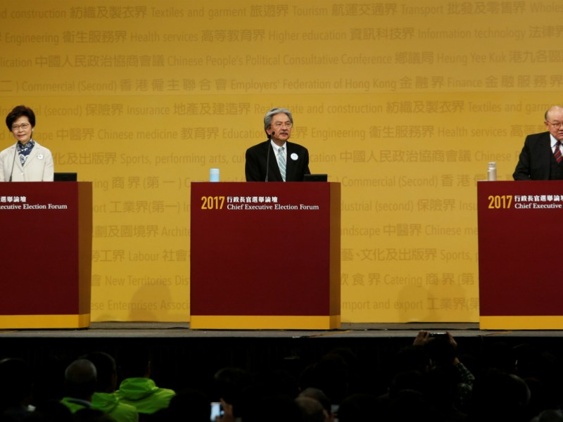 Chief Executive candidates (L-R) former Chief Secretary Carrie Lam, former Financial Secretary John Tsang and retired judge Woo Kwok-hing take part in a debate in Hong Kong, China March 19, 2017. Photo: Reuters/Bobby Yip