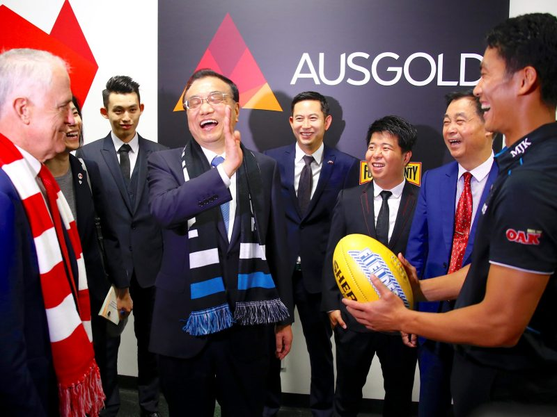Australia's Prime Minister Malcolm Turnbull watches as Chinese Premier Li Keqiang laughs with Port Adelaide player Chen Shaoliang. Photo: Reuters/David Gray