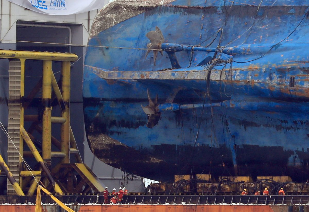 The sunken ferry Sewol sits on a semi-submersible ship during its salvage operations at the sea off Jindo, South Korea,  March 26, 2017.  Yonhap via REUTERS   ATTENTION EDITORS - THIS IMAGE HAS BEEN SUPPLIED BY A THIRD PARTY. SOUTH KOREA OUT. FOR EDITORIAL USE ONLY. NO RESALES. NO ARCHIVE.