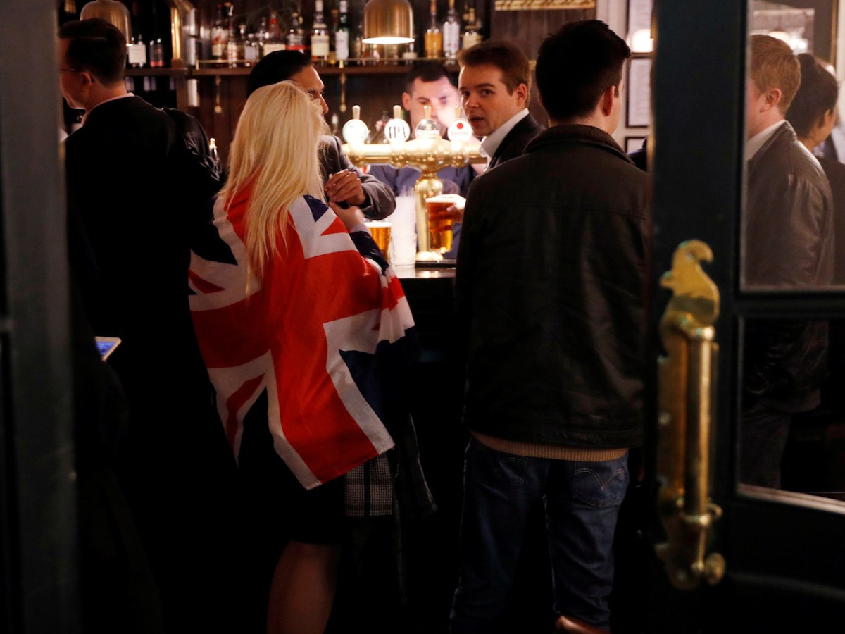 Britons in a London bar on March 29, 2017, celebrate the invoking of Article 50 after Prime Minister Theresa May triggered the process by which the United Kingdom will leave the European Union. Photo: Reuters/Peter Nicholls